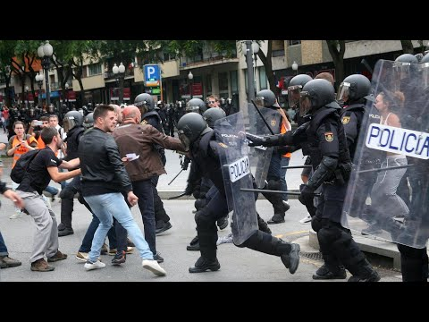 Catalan referendum: hundreds injured as police attack protesters