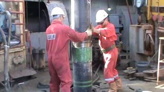 Power Tong Guys Running Casing Tool on the Oil & Gas Drilling Rig - Part 09
