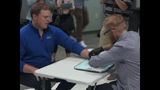 WI Employees Volunteer to Get Microchip in Hands