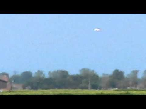 UFO close to Viking Town hovering over farmland roadway