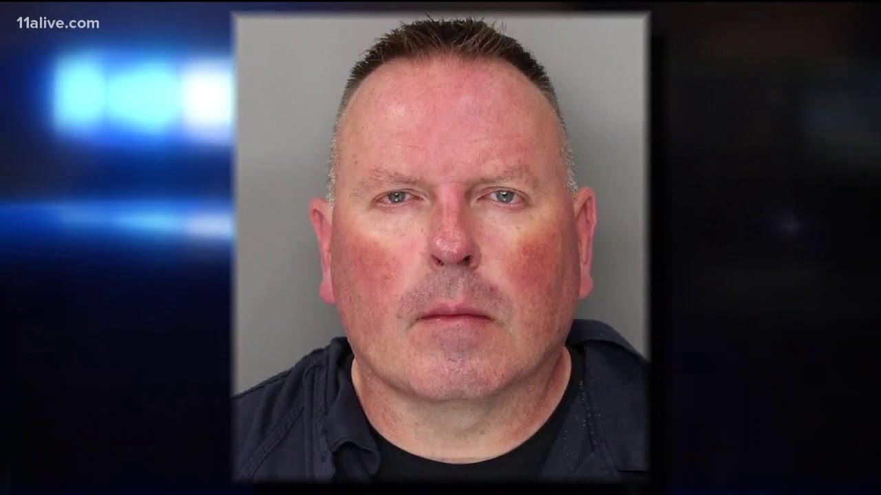 New warrants: Cobb officer accused of strangling 'developmentally delayed' woman