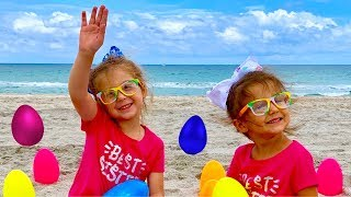 Egg Hunt Surprise Toys for Kids at the Beach with Elya and Adelya