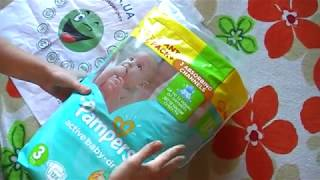 Розпакування підгузників Pampers Active Baby-Dry (Midi) 5-9 кг 124 шт з Rozetka.com.ua