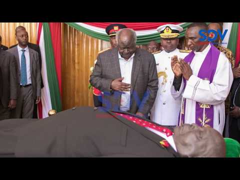 Former President Mwai Kibaki views Mzee Moi's body in Parliament