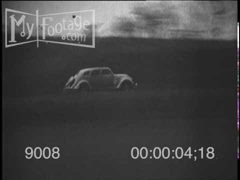 1938 Ford V-8 Sedan Automobile Driving Hillside