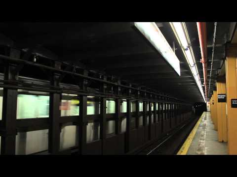 IRT Subway: Manhattan Bound R142 (5) Train Passes Kingston Avenue