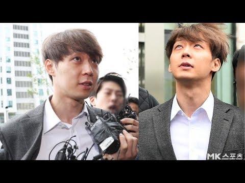 JYJ Yoo Chun Has STRANGE Expression While Being Handcuffed