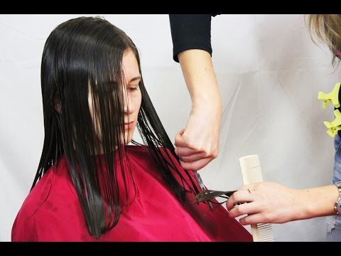 Nice woman getting an haircut from long to medium and charmy style