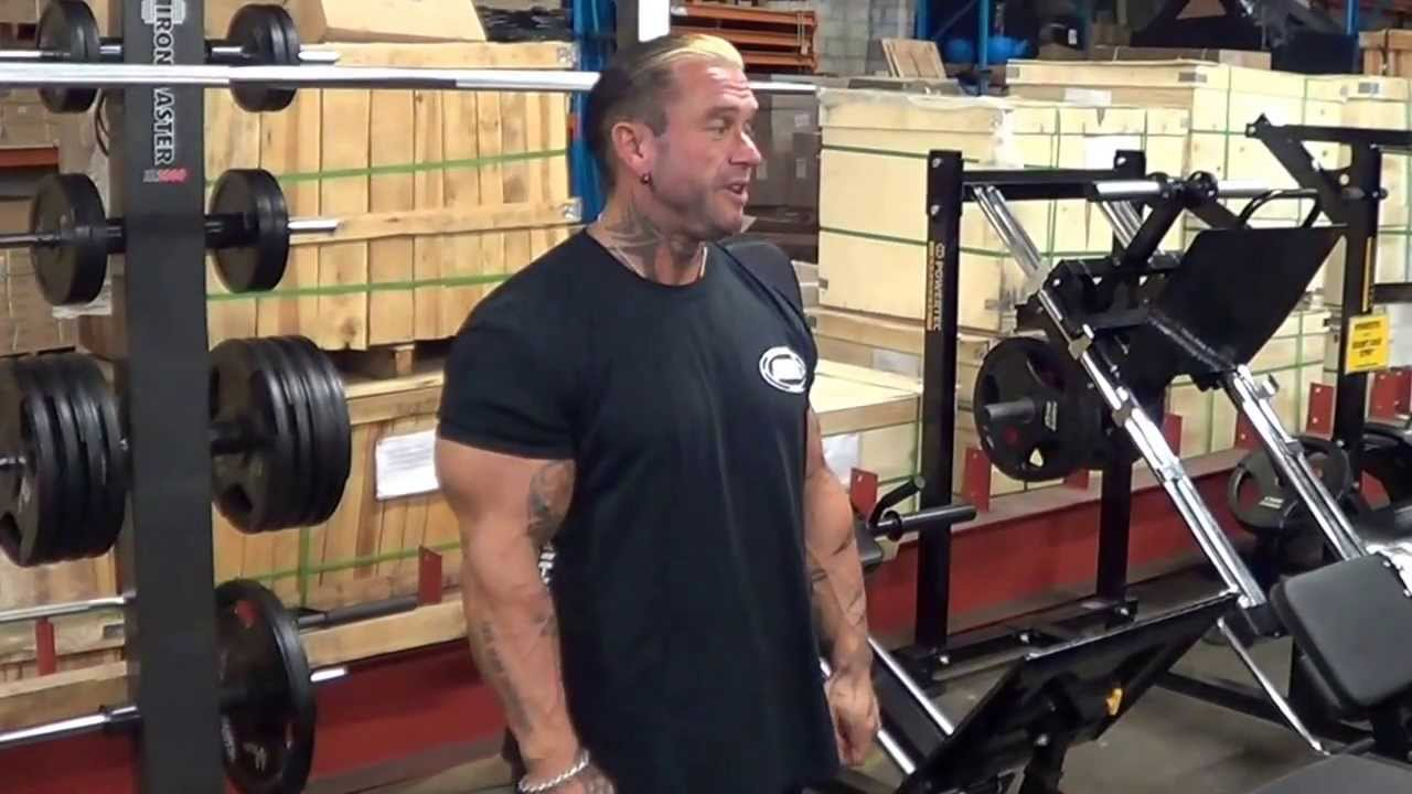Lee Priest Doing Leg Extensions On Ironmaster Super Bench