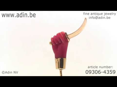 Victorian gold stickpin coral hand holding large knife small sword. (Adin reference: 093064359)
