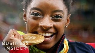 Here's Why Olympic Athletes Bite Their Medals
