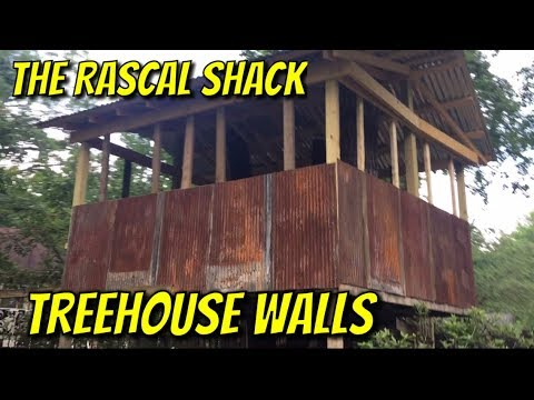 Treehouse/ installing metal wall panels
