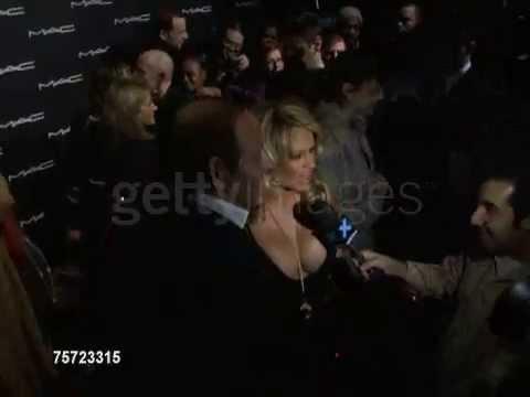 Pamela Anderson (close to his boobs) thumbnail