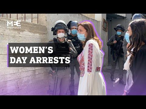 Israeli soldiers arrest Palestinian women during International Women's Day event