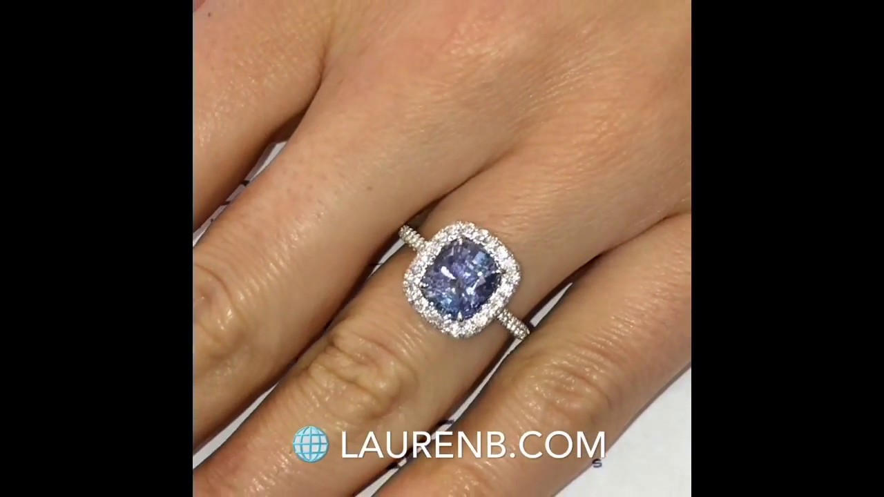band diamond sapphires handcrafted platinum pure setting sapphire a featuring shared cushion cut and diamonds dazzling prong in