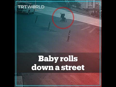 Baby in a stroller rolls down a busy street in Turkey