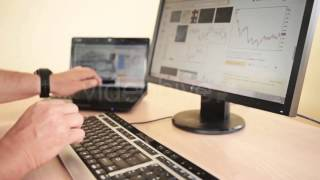 Stock Footage - Designing At Wood Desk With Wireframe And Computer | Videohive