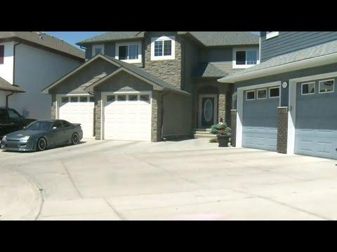 City of Calgary cracks down on 'super driveways'