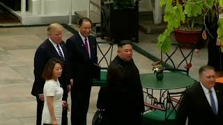 Trump and Kim stroll through hotel garden in Hanoi