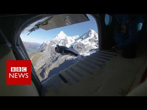 Daredevils jump from a mountain into a plane- BBC News