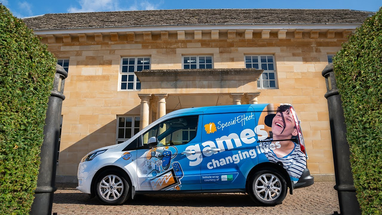 Adept Graphics - Delivering a free van wrap to specialeffect charity DPF 6100XLP