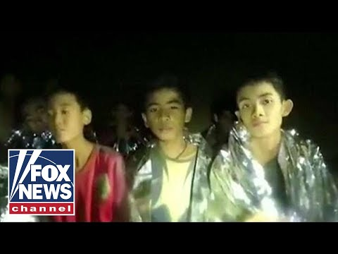 13 trapped in Thailand cave in stable condition