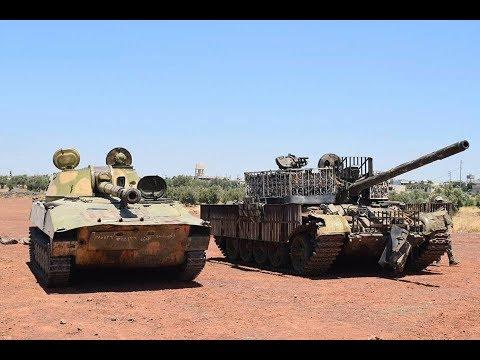 SYRIA: FSA militants hand over equipment to Quneitra