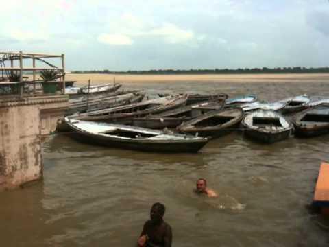 Swimming in the sacred river Ganga, India