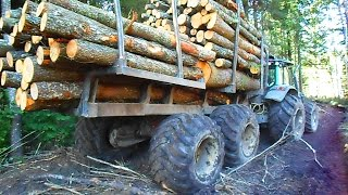 Valtra forestry tractor with large homemade trailer