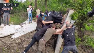 Fences toppled as tensions flare at protest over construction in Kiev forest