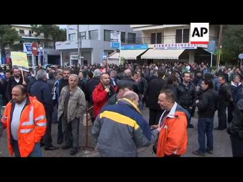 Transport workers demonstrate against layoffs, pay cuts
