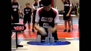 Kid breaks the cup stacking world record and his buddies lose their minds! Wow.