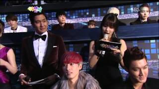 IU and Eunhyuk were spotted together on TV screen