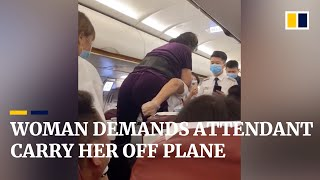 Woman demands flight attendant carry her off plane, after being asked to leave