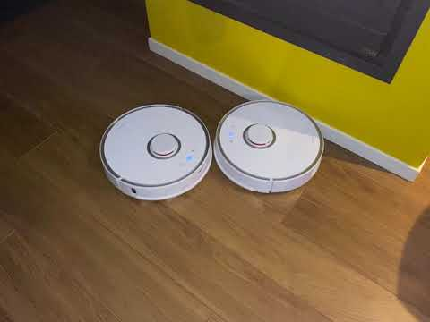 battle of the robot vacuums!