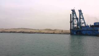 Dredgers deepen Western Port Said Island Albulah at the beginning of the new Suez Canal