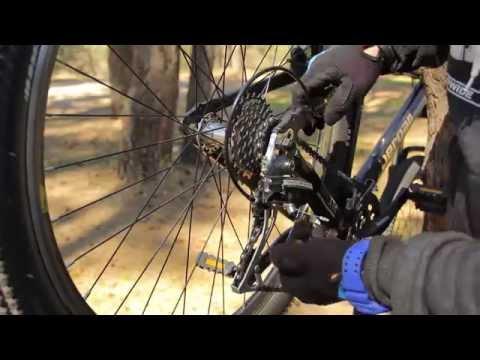 Настройка заднего переключателя велосипеда.