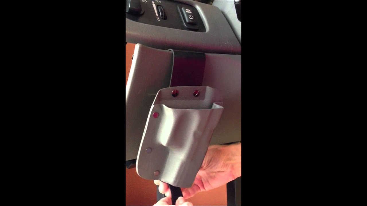 UNDER THE STEERING COLUMN HOLSTER -