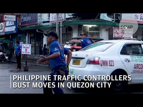 Philippine traffic controllers bust moves in Quezon City