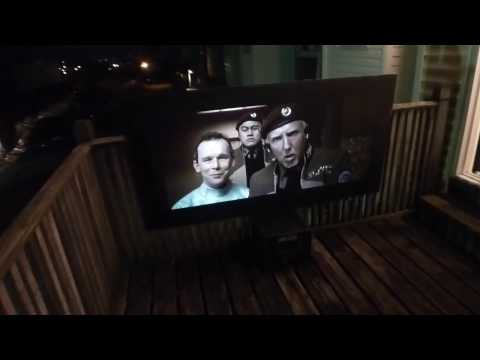 WATCHING A MOVIE OUTSIDE ON A JET BLACK BACKYARD THEATER PROJECTION SCREEN!