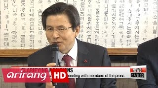 Hwang indicates suspended president's key policies will continue in lunch with the press
