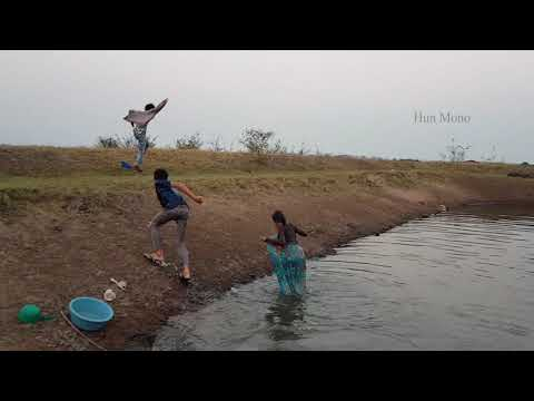 A young girl have a bath in the pond with a boy so happy