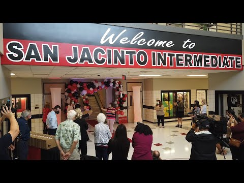 Surprise laptop distribution for teachers at San Jacinto Intermediate School