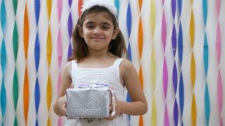 Portrait of smiling little girl holding birthday gift