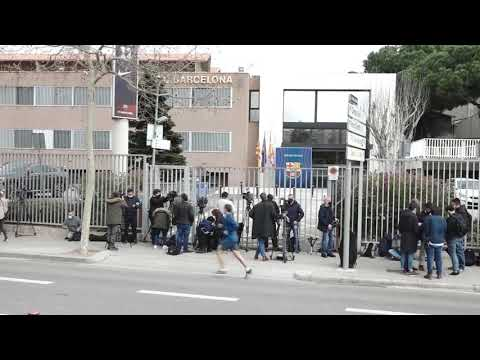 Media crews gather outside Barcelona offices after police raid stadium