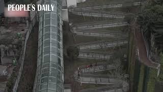 300-meter-long zigzag walkway with 19 hairpin turns in SW China's Chongqing