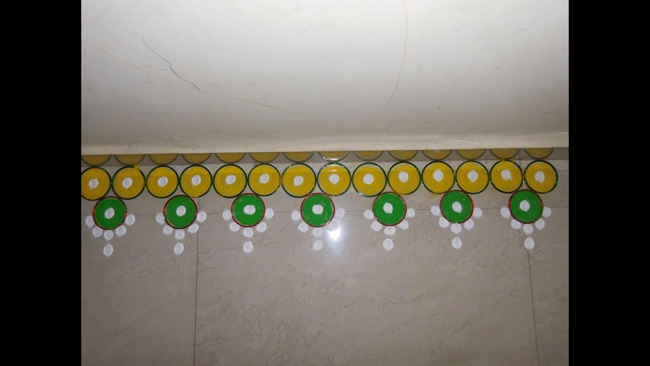 Colorful border rangoli new youtube for Door entrance rangoli designs