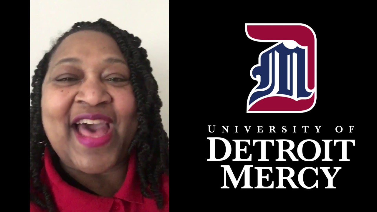 University of Detroit Mercy Associate Dean of Students Dorothy Stewart congratulates the Titan Class of 2020 and standout senior Dohna Dudley.