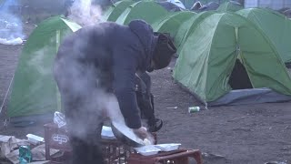 Iranian migrants pitch tents in Calais, desperate to reach UK