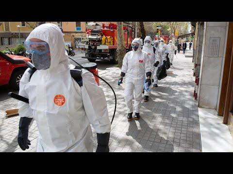 Spain death toll surpasses 10,000